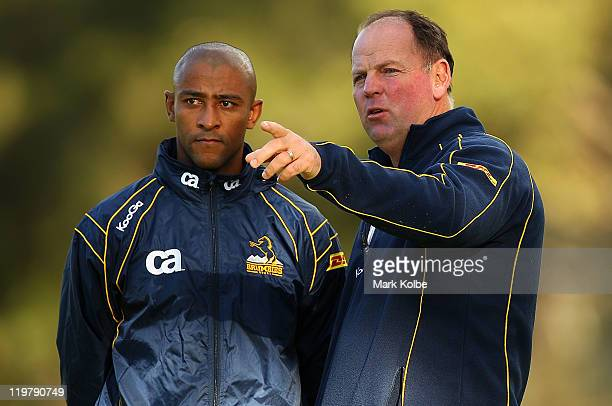 Consultant coach George Gregan and head Coach Jake White speak as they watch on at a skills session during an ACT Brumbies training camp at Narrabeen...