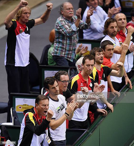 Consultant Niki Pilic of Germany and fitness and mental coach Carlo Thraenhardt of Germany celebrate during day one of the Davis Cup World Group...