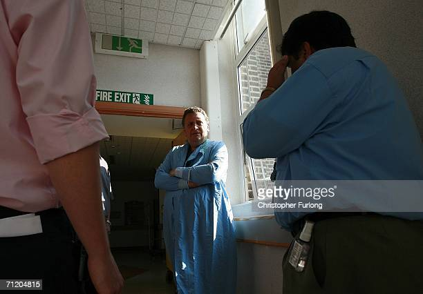 Consultant Surgeon Andrew Ready chats with his tea of doctors after conducting a live donor kidney transplant at The Queen Elizabeth Hospital...