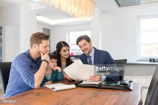 Consultant talking to family at home