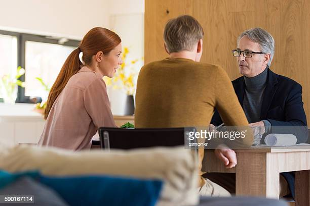 Consultant talking with couple