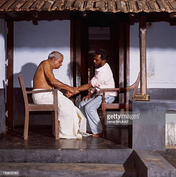 Consultation despite he is 81 years old master Balan actively continues his village doctor and bonesetter career On the picture he relieves a patient...