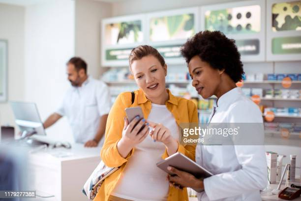 consultation - pharmacy stock pictures, royalty-free photos & images