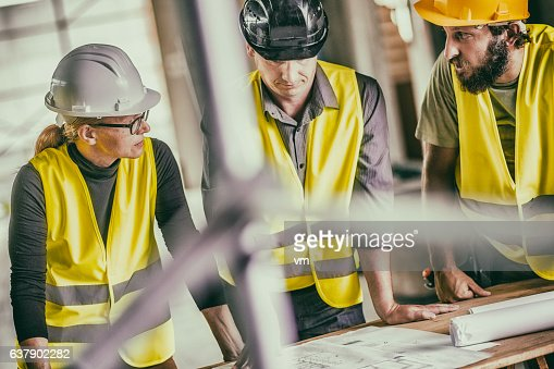 Consulting about blueprints on a reconstruction site stock photo similar images malvernweather Images