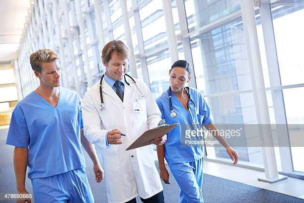 Consulting his medical colleagues