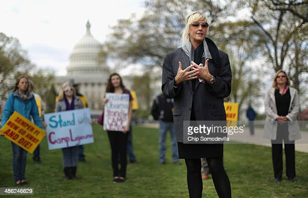 Consumer advocate Erin Brockovich addresses a rally against the federal government's support for what they say is a known polluter on Capitol Hill...