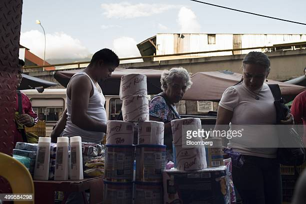 Consumer goods are displayed for sale in the Petare neighborhood of Caracas Venezuela on Thursday Nov 12 2015 Thousands of Venezuelans have left...