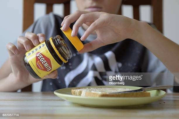 A consumer opens a jar of Vegemite spread in an arranged photograph in Melbourne Australia on Thursday Jan 19 2017 Bega Cheese Ltd who has acquired...