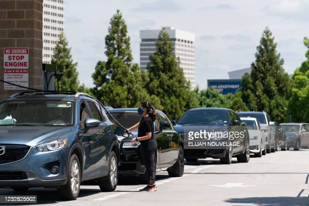Consumer pumps gas at a Costco gasoline station on May 11 in Atlanta, Georgia. - Fears the shutdown of a major fuel pipeline would cause a gasoline...