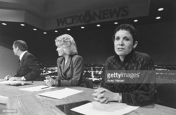 TV consumer reporter multiple sclerosis victim Ellen MacFarlane sitting w coanchors Glenn Rinker Michelle Muro on set during commercial break at...