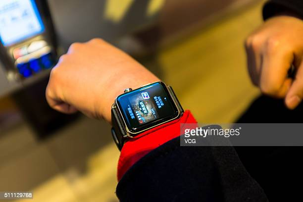 A consumer uses Apple Pay on the Apple Watch at a McDonald's on February 18 2016 in Beijing China Apple CEO Tim Cook has today confirmed the launch...