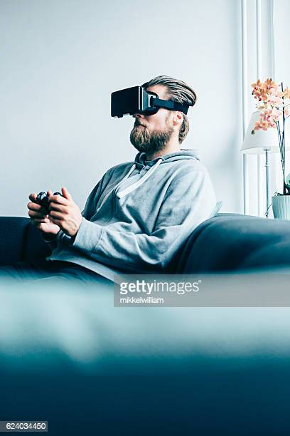 Consumer wears smart glasses and plays game at home
