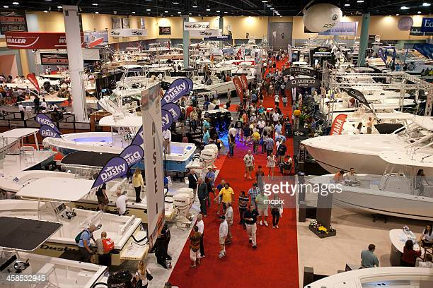 consumers at a boat show. - tradeshow stock pictures, royalty-free photos & images