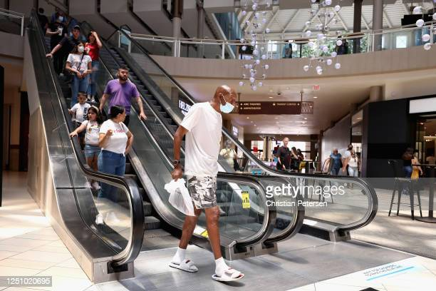 Consumers exit an escalator as they return to retail shopping at the Arrowhead Towne Center on June 20 2020 in Glendale Arizona Arizona is one of the...