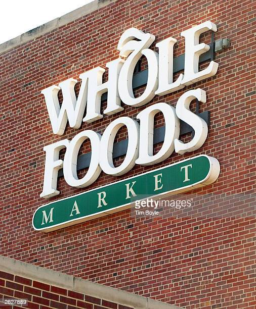 Consumers exit and enter a Whole Foods Market store October 22, 2003 in Chicago. Austin, Texas-based Whole Foods Market has planned to become the...