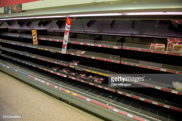 Consumers leave shelves empty in a London Morrisons store as panic-buying over coronavirus continues on March 14, 2020 in London England. Members of...