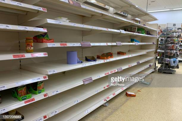 Consumers leave shelves empty in a London Sainsbury's store as panicbuying over coronavirus continues COVID19 on March 14 2020 in London UK