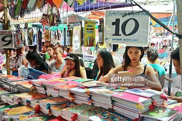 Consumers look through school supplies in Divisoria, Manila on May 27, 2014. Divisoria is known for its wide assortment of low-priced goods and...