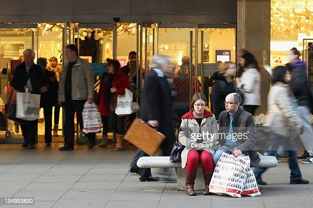 Consumers peruse the shops on Oxford Street with less than three weeks before Christmas Day on December 5 2011 in London England Online Christmas...