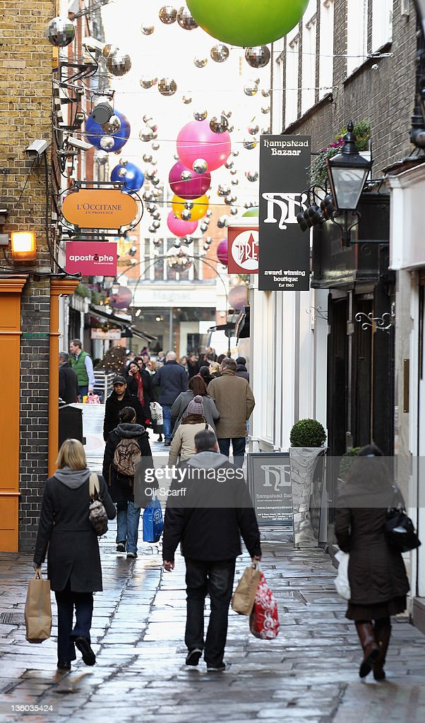 Consumers peruse the shops on St Christopher's Place on the penultimate Saturday before Christmas Day on December 17, 2011 in London, England. Retail analysts have predicted that today will be the busiest day of the year for high street gift purchases with spending set to exceed 1 billion GBP.