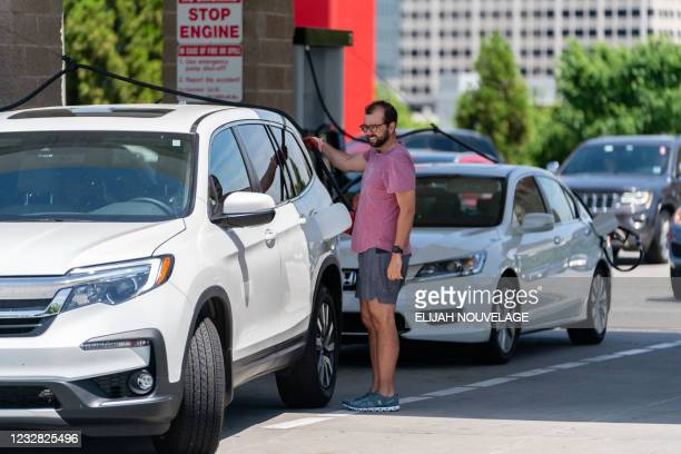 Consumers pump gas at a Costco gasoline station on May 11 in Atlanta, Georgia. - Fears the shutdown of a major fuel pipeline would cause a gasoline...