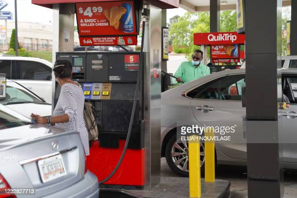 Consumers pump gas at a QuikTrip gas station on May 11 in Smyrna, Georgia. - Fears the shutdown of a major fuel pipeline would cause a gasoline...