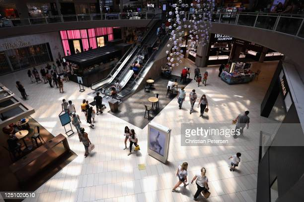 Consumers return to retail shopping at the Arrowhead Towne Center on June 20 2020 in Glendale Arizona Arizona is one of the 19 states with the trend...
