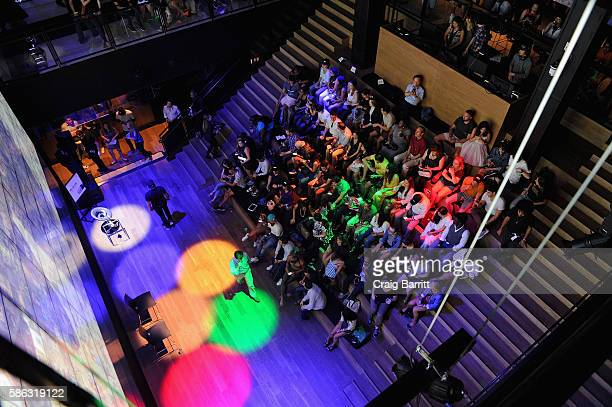 """Consumers watch a livestream during a """"Rio Remotely"""" event celebrating the 2016 Olympic Opening Ceremony at Samsung 837 on August 5, 2016 in New York..."""