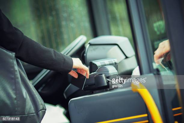 contacless payment with rfid card on the public transportation - nfc stock pictures, royalty-free photos & images