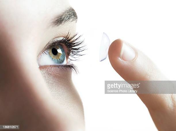 contact lens use - contacts stock photos and pictures