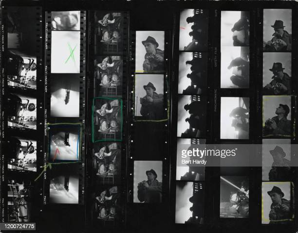 A contact sheet from a Picture Post magazine story depicting firefighters tackling a blaze during the Blitz London 1941 the images include portraits...