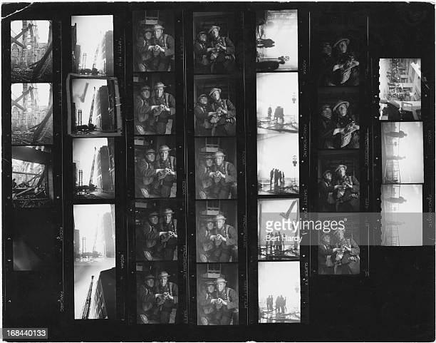 A contact sheet from a Picture Post magazine story depicting firefighters tackling a blaze during the Blitz London 1941 Original publication Picture...
