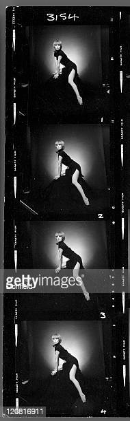 A contact sheet of British actress and model Joanna Lumley wearing a long black dress with a high split in her role as Purdey in The New Avengers on...