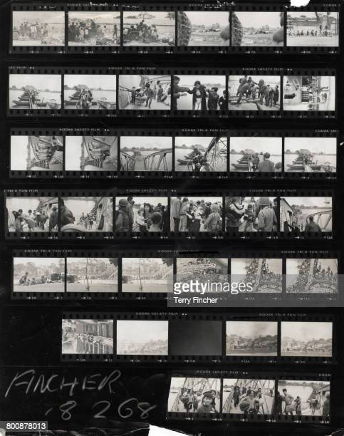 A contact sheet showing Vietnamese refugees crossing the wrecked Trung Tin Bridge over the Perfume River during the Battle of Hu Vietnam War February...