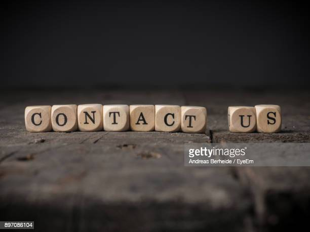 Contact Us Text Blocks On Wooden Table