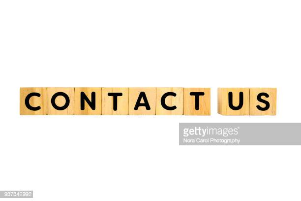 contact us text on wooden blocks on white bcakground - contact us stock pictures, royalty-free photos & images