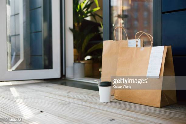 contactless food delivery - take away food stock pictures, royalty-free photos & images