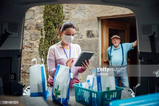 contactless medicine delivery - essential services stock pictures, royalty-free photos & images