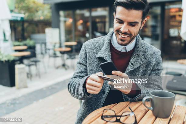 contactless mobile payment - money transfer stock pictures, royalty-free photos & images