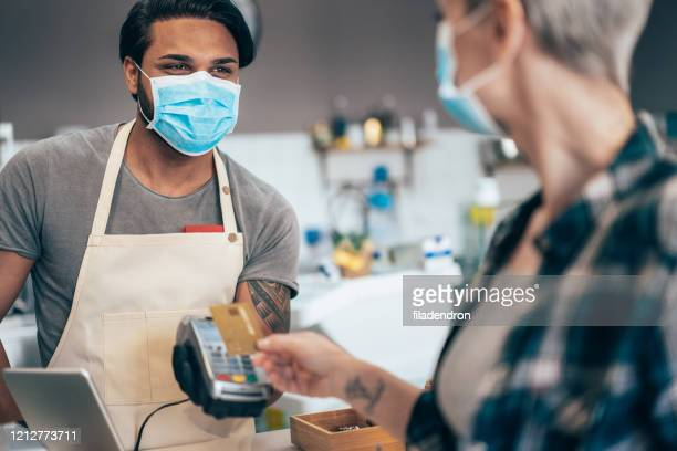contactless payment and coronavirus - covid 19 stock pictures, royalty-free photos & images