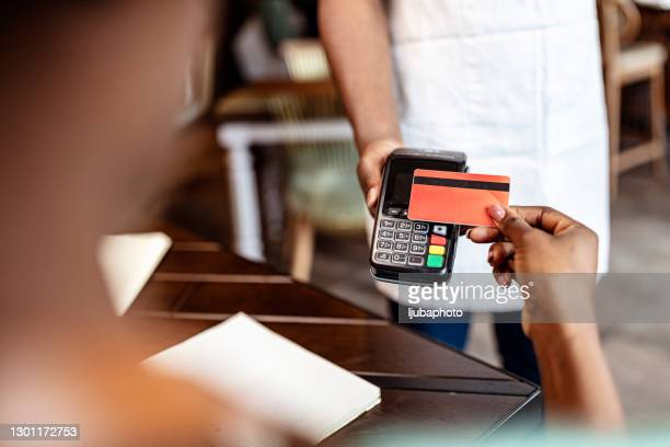contactless payment at a cafe - paying stock pictures, royalty-free photos & images