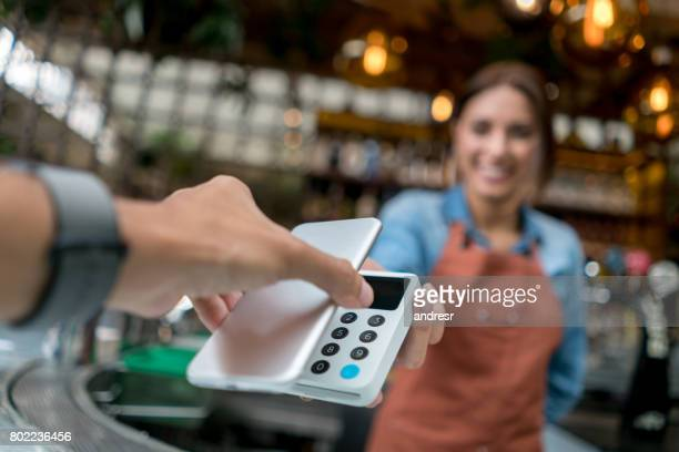 Contactless payment at a restaurant with a cell phone