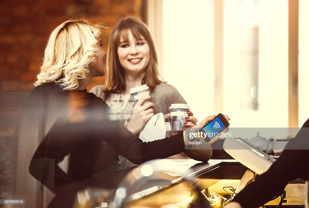Contactless payment at the coffee shop : Stock Photo