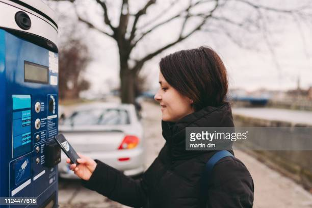contactless payment for parking place in the city - parking meter stock photos and pictures