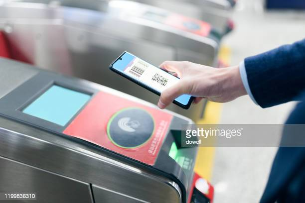 contactless payment for subway ticket with smart phone - charging sports stock pictures, royalty-free photos & images