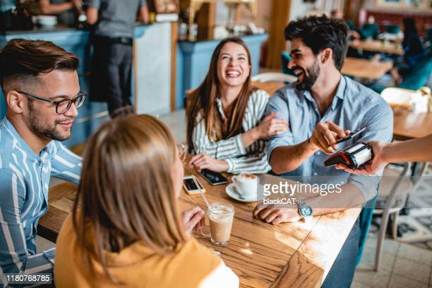 contactless payment in a coffee shop - restaurant stock pictures, royalty-free photos & images