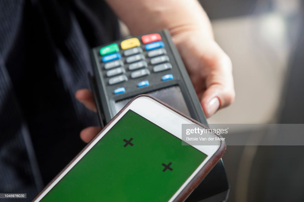Contactless payment made with mobile phone using card reader. : Stock Photo