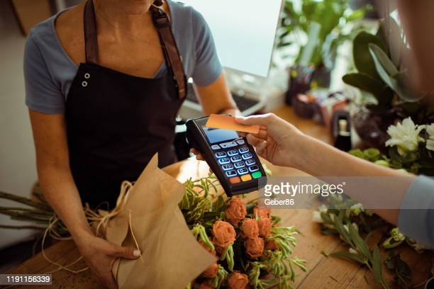 contactless payment - credit card reader stock pictures, royalty-free photos & images