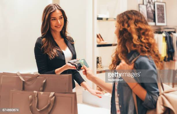 contactless payment - saleswoman stock photos and pictures