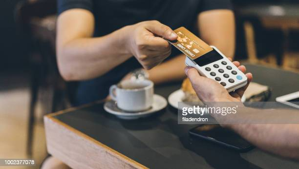 contactless payment with credit card - money transfer stock pictures, royalty-free photos & images